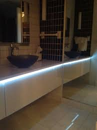 Condo Bathroom Ideas by How To Use Lighting Mirrors Vanities And Color In A Condo Bath