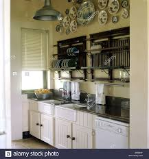 kitchen scullery with plate racks and white sinks stock photo