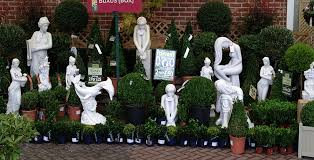 statues sculptures and planters enigma home and garden