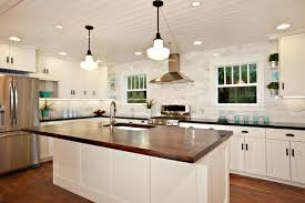 white kitchen wood island white kitchen with wood island carrara backsplash black granite