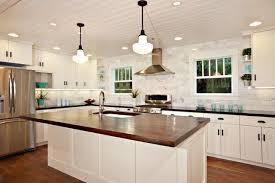 black granite kitchen island white kitchen with wood island carrara backsplash black granite
