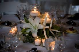 beach themed wedding centerpieces with coral ornaments and candles