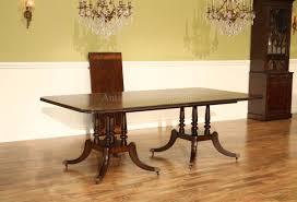 mahogany dining table with crossbanded crotch mahogany field