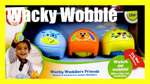 wacky waddler friends toy wobble and roll toy with dog cat and