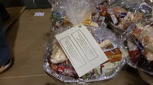 thanksgiving food gift baskets thanksgiving basket brigade volunteers prepare donations to needy
