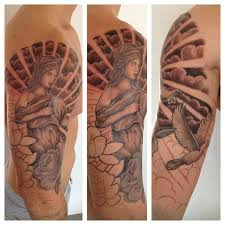 collection of 25 clouds and helmet warrior tattoos on half sleeve