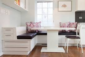 furniture black banquette seating with pattern cushions and white