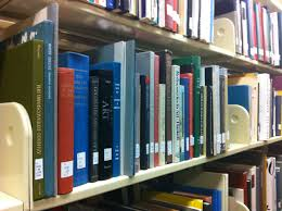 file art books on library shelf jpg wikimedia commons