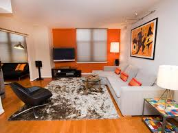 Orange Accent Wall by Adorable Printed Rug And Orange Accent Wall Using Soft Grey Couch