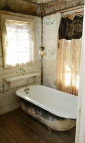 small bathroom with clawfoot tub and separate shower
