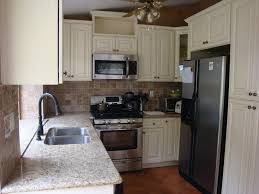 antique white cabinets u0026 venetian gold granite counter tops
