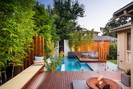 Houzz Backyards The Wooden Deck Around The Pool The Landscaping Houzz