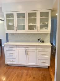 white mosaic tiles with glass subway tiles installed in kitchen