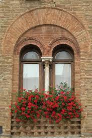 ravishing tuscan window shutters featuring wooden window frame