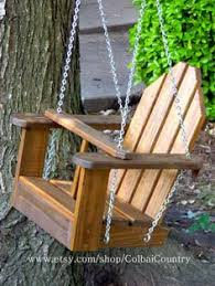 baby swing swing set kids wooden swing hang on a beautiful tree limb on your porch