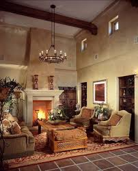 tuscan living room with high ceiling and traditional chandelier