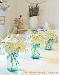 jar floral centerpieces summer decorating ideas for the dining room town country living