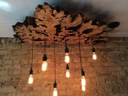 made large live edge olive wood chandelier with edison bulbs