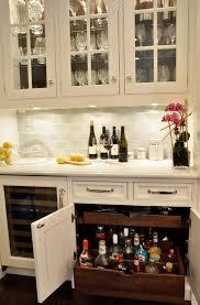 frosted white glass subway tile liquor bottles cabinet design