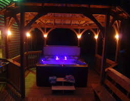 Patio Torch Lights by Night View Of Our Hot Tub With The Wine Bottle Tiki Torches Lit