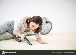 woman vacuuming carpet u2014 stock photo igortishenko 140179184