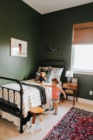 best 25 dark green rooms ideas on pinterest dark green walls toddler room iron bed dark green walls big boy room boy nursery