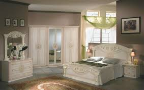 tuscan bedroom colors white wall paint color wooden bed frame