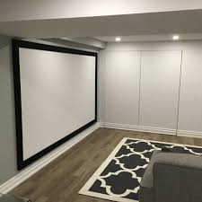 basement living room home theater modern with gray sofa walls