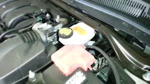 2013 ford taurus limited sedan checking dot4 brake fluid while