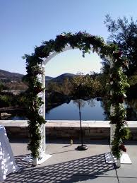 an arch pew decorations and pool flowers