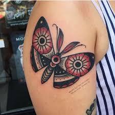 steam eye in butterfly on left shoulder