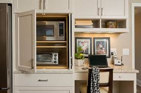 Under The Cabinet Toaster An Appliance Garage Conceals The Microwave And Toaster Oven For