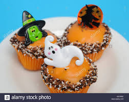 a still life image of halloween themed cupcakes decorated with a