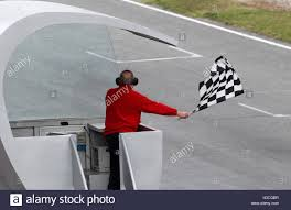 Finish Line Flag Chequered Flag Being Waved At Finish Line Of A Grand Prix Stock