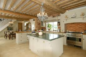 spacious open kitchen white cabinets and island with wooden