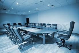 Modern Conference Room Tables by Large Table And Chairs In A Modern Conference Room Stock Photo