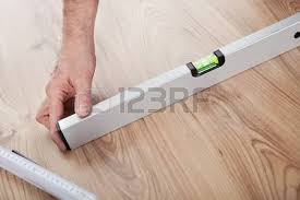 carpenter worker installing laminate flooring in the room stock