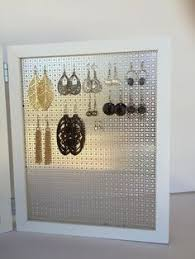 store stud earrings my altered tolsby frame now an earring holder