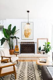 mid century modern living room with fireplace neutral