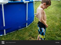Pool In Backyard by Little Boy By Pool In Backyard Stock Photo Offset