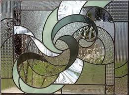 Home Windows Glass Design This Abstract Window Is A Perfect Complement To A Modern Master