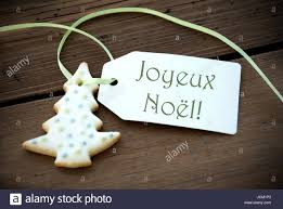 a tree cookie with a label with the words joyeux