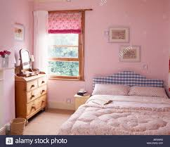 pink blind and white curtain on window in pastel pink country