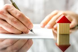 man signing a contract when buying a new house royalty free stock