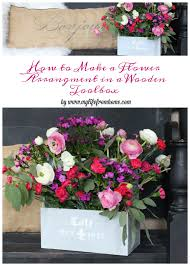 how to make a flower arrangement in a wooden toolbox flowers