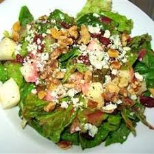 salad greens pears walnuts and gorgonzola are tossed in a