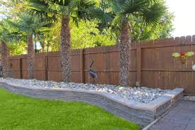 scenic rowing palm trees next to wooden retaining wall ideas along