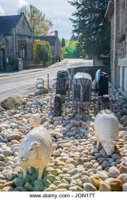 ornamental sheep and a vintage grey ferguson tractor outside the