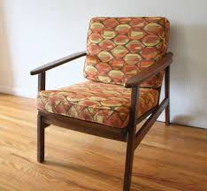 mid century modern arm chair with geometric pattern cushions