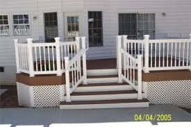 lattice with stained and white trim around the house outside